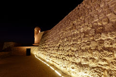 Watch tower and lighted southern walls of Bahrain fort Royalty Free Stock Photography