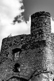 Watch tower of a medieval castle ruins. In Polish region of Jura. Black and white picture Stock Photo