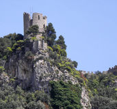 Watch Tower. A medival tower still stands overlooking the sea Stock Photo