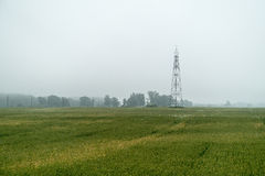 Watch tower in the misty field Stock Photo
