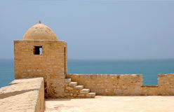 Watch Tower And Sea. Under the blue sky Stock Image