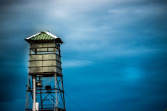 A watch tower. A security guard post of a prison or a jail for protection and vigilance Royalty Free Stock Image