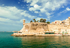 Watch tower and the walls of Valletta. At Gardjola Gardens in Senglea, Malta Stock Image