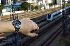 Watch and train. Watch on first plan and fast train as background - concept of being late, time schedule Stock Photos