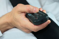 Watch tv. Pilot for tv in hand Stock Photography