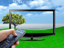 Watch tv concept with hand Royalty Free Stock Images