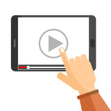Watch video on tablet computer. Hand pointing to play button on a tablet computer to watch video tutorial on line stock illustration