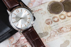 Watch and wallet on banknote Stock Image