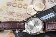 Watch and wallet on banknote Royalty Free Stock Photography