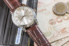 Watch and wallet on banknote Stock Photos