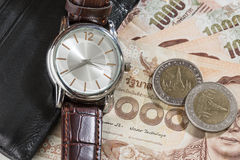 Watch and wallet on banknote Stock Images