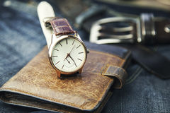 Watch,wallet and jeans. On table Stock Images