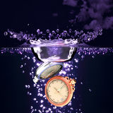 Watch into water. Stock Photography