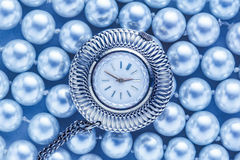 Watch on white pearl Royalty Free Stock Photography