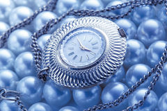 Watch on white pearl Stock Image