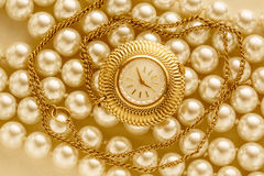 Watch on white pearl Royalty Free Stock Photos