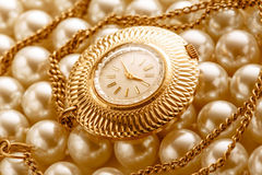 Watch on white pearl Royalty Free Stock Images