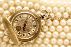 Watch on white pearl Royalty Free Stock Photo