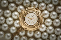 Watch on white pearl Stock Photos