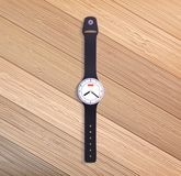 Watch on wooden table. Stock Photos