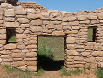Watch Your Head. Door and two windows to ancient Anasazi dwelling royalty free stock photography