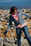 Watch your step. Woman walking on some rocks on top of Mount Washington Royalty Free Stock Photo
