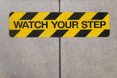 Watch your step construction warning sign Royalty Free Stock Image
