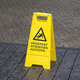 Watch your step sign on the floor Stock Images