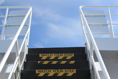 Watch your Step sign on outside stairs Royalty Free Stock Images