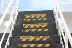 Watch your Step sign on outside stairs Royalty Free Stock Photos