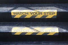 Watch your Step sign on stairs Stock Photography