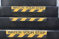 Watch your Step sign on stairs Royalty Free Stock Images