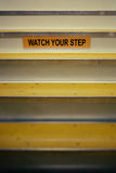Watch Your Step Sign on Stairway Stock Image