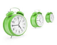 Watches alarm facing each other in a row with Royalty Free Stock Image