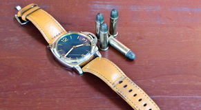 Watches and ammunition Royalty Free Stock Photography