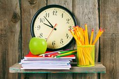Watches, an apple and school accessories . Royalty Free Stock Images