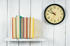 Watches and books on a wooden shelf. Royalty Free Stock Photography