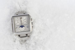 Watches&christmas. Wrist watches under snow in christmas time Royalty Free Stock Images