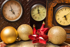 Watches and christmas balls Stock Image