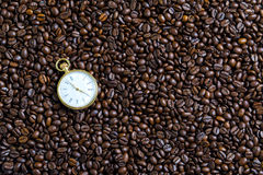 Watches and coffee beans. Watches and smooth surface of the coffee beans Stock Image