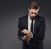 Watches complete a classic suit Royalty Free Stock Photos