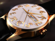 Watches. Gold watches close-up on the table with white dial, currency icons and ticking arrow Royalty Free Stock Photo