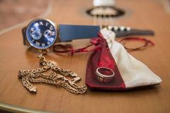Watches, gold ring, bracelets and guitar Royalty Free Stock Photos