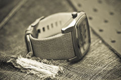Watches and jeans and leather Belt. Vintage style stock photo