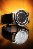 Watches with leather strap on a flame background Royalty Free Stock Image
