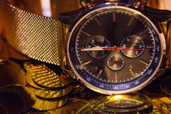 Watches for men gold. Men`s watch, close-up golden hand watch. Best accessories for man royalty free stock image