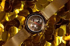 Watches for men gold. Men`s watch, close-up golden hand watch. Best accessories for man royalty free stock photo