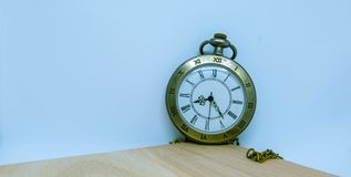 Watches, necklaces placed at the corners and on the wood royalty free stock photo