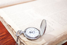 Watches over book Royalty Free Stock Photo