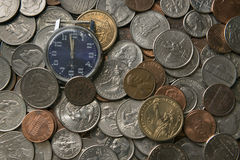 Watches in placers American coins of various face values. Old watches in placers American coins of various face values Royalty Free Stock Image